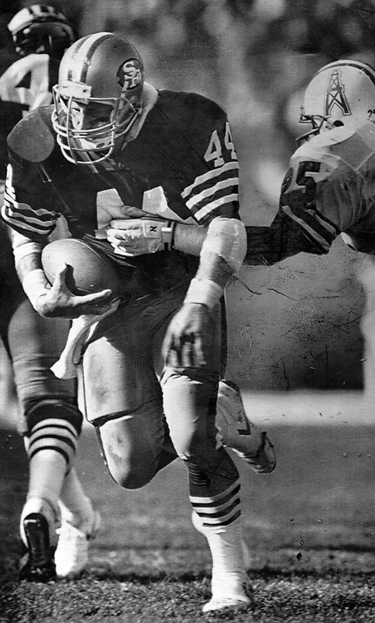 San Francisco 49ers running back Tom Rathman brushes off a tackle in the game Nov. 9, 1987 against the Houston Oilers.