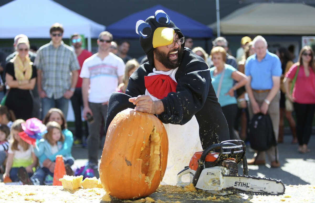 Rob Beck, aka Chilly Willis, works on his creation during the Texas Chainsaw Pumpkin Carving Contest at the annual Fremont Oktoberfest on Saturday, Sept. 21, 2013.