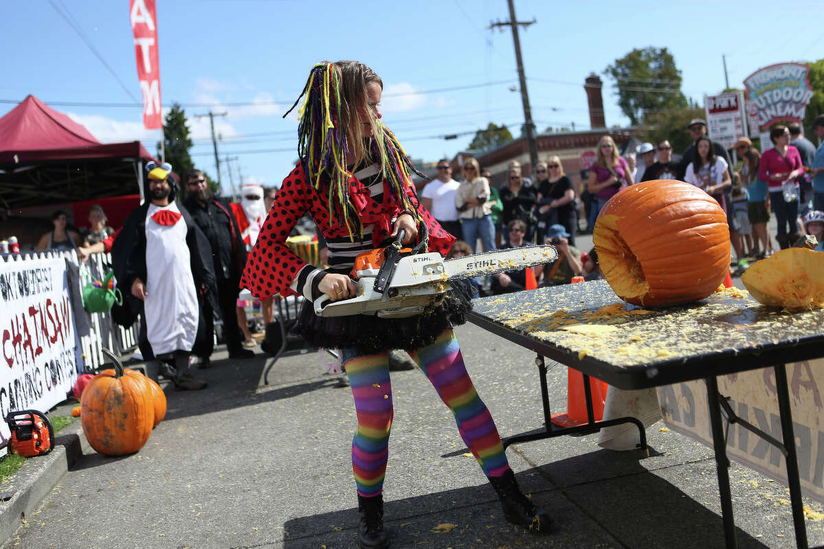 Rina Jensen, aka Blinkie the Clown, works on her creation during the Texas Chainsaw Pumpkin Carving Contest at the annual Fremont Oktoberfest on Saturday, Sept. 21, 2013.