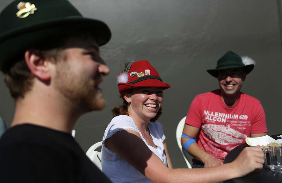 From left, Mike Poppe, Amy McCurdy and John McCurdy wear Bavarian attire during the annual Fremont Oktoberfest on Saturday, Sept. 21, 2013. Photo: JOSHUA TRUJILLO, SEATTLEPI.COM / SEATTLEPI.COM