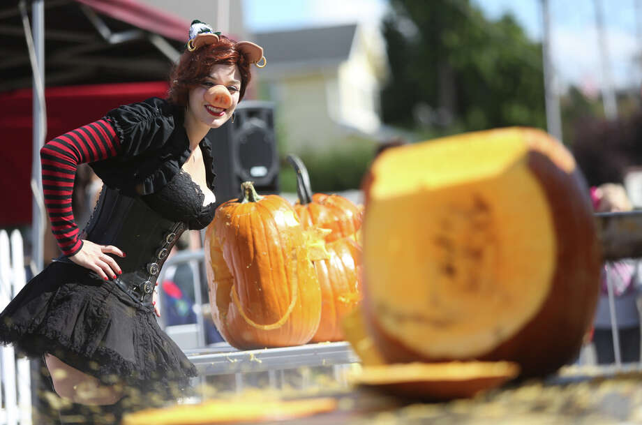 Jessica Starling, aka Polly Pig, watches the action during the Texas Chainsaw Pumpkin Carving Contest at the annual Fremont Oktoberfest on Saturday, Sept. 21, 2013. Photo: JOSHUA TRUJILLO, SEATTLEPI.COM / SEATTLEPI.COM