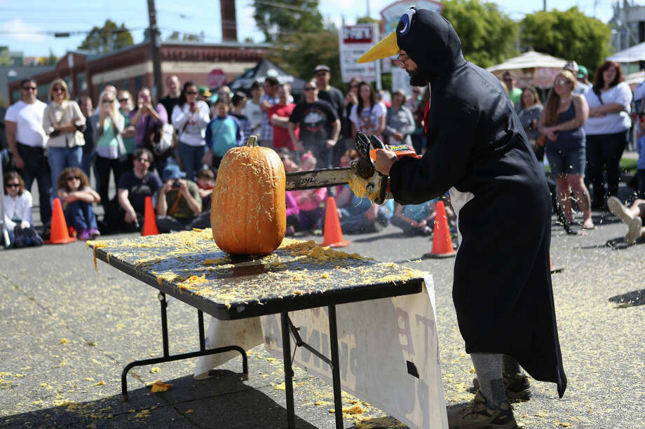 Rob Beck, aka Chilly Willis, works on his creation during the Texas Chainsaw Pumpkin Carving Contest during the annual Fremont Oktoberfest on Saturday, Sept. 21, 2013. Photo: JOSHUA TRUJILLO, SEATTLEPI.COM / SEATTLEPI.COM