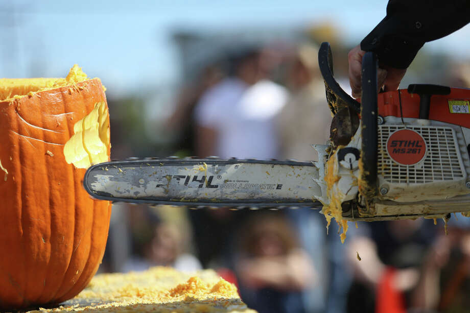 A chainsaw takes care of business during the Texas Chainsaw Pumpkin Carving Contest at the annual Fremont Oktoberfest on Saturday, Sept. 21, 2013. Photo: JOSHUA TRUJILLO, SEATTLEPI.COM / SEATTLEPI.COM