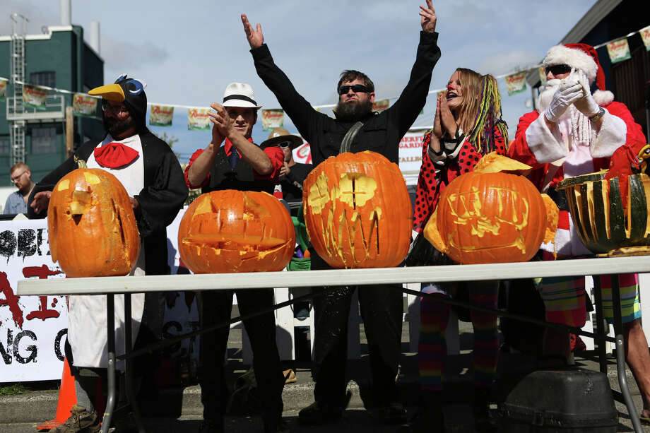 Participants wait as the crowd decides a winner during the Texas Chainsaw Pumpkin Carving Contest at the annual Fremont Oktoberfest on Saturday, Sept. 21, 2013. Photo: JOSHUA TRUJILLO, SEATTLEPI.COM / SEATTLEPI.COM
