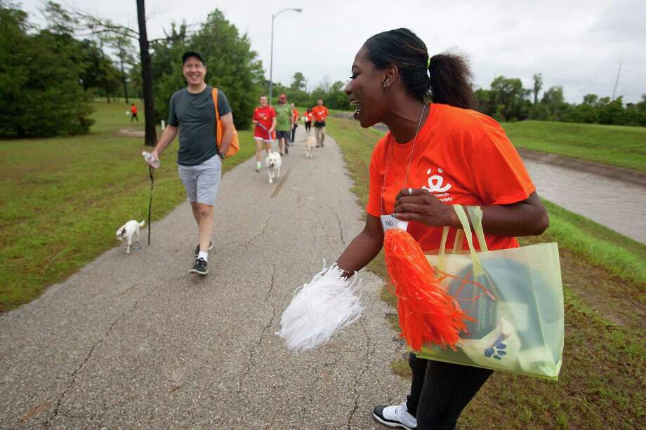 Niki Sims cheers on hundreds of dogs and their owners walked around T.C. Jester Park during the Best Friends Animal Society Strut Your Mutt walk and fundraiser. For more information visit: www.strutyourmutt.org Photo: Johnny Hanson, Houston Chronicle / Houston Chronicle