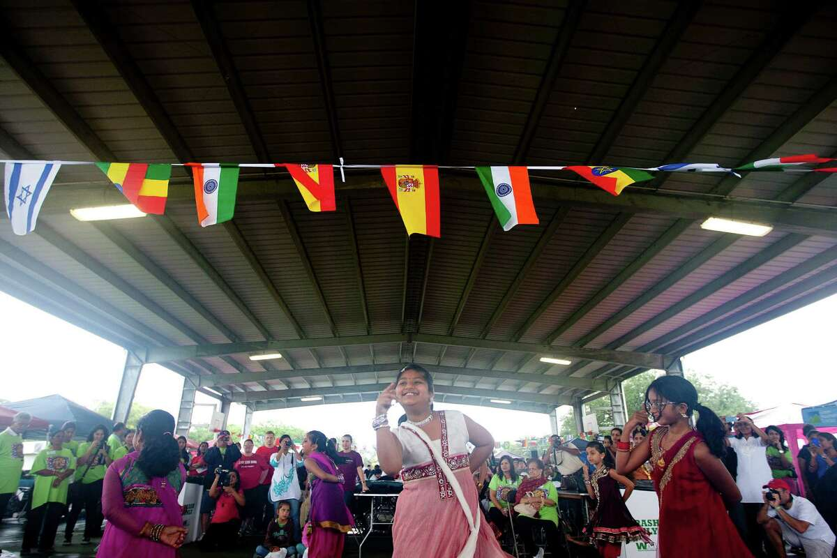 Dancers with Shingari's School of Rhythm perform at the Pearland International Festival in Independence Park Saturday, Sept. 21, 2013, in Pearland.