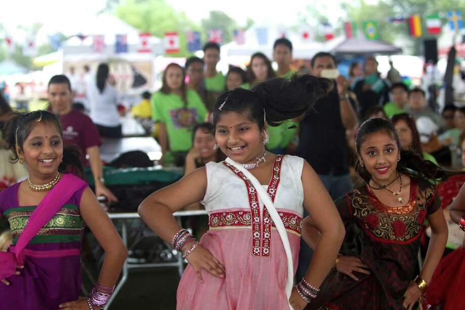 Dancers with Shingari's School of Rhythm performs at the Pearland International Festival in Independence Park Saturday, Sept. 21, 2013, in Pearland. Photo: Johnny Hanson, Houston Chronicle / Houston Chronicle