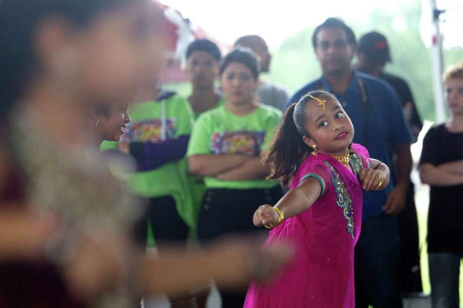 Aryah Ahamad, 8, with Shingari's School of Rhythm, performs at the Pearland International Festival in Independence Park Saturday, Sept. 21, 2013, in Pearland. Photo: Johnny Hanson, Houston Chronicle / Houston Chronicle