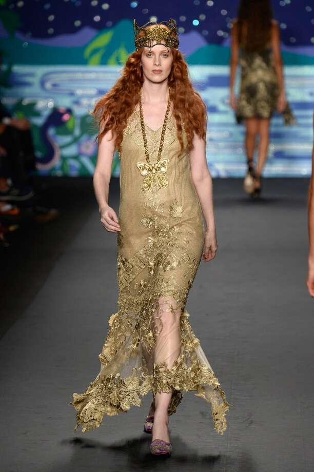 NEW YORK, NY - SEPTEMBER 11:  Model Karen Elson walks the runway at the Anna Sui fashion show during Mercedes-Benz Fashion Week Spring 2014 at The Theatre at Lincoln Center on September 11, 2013 in New York City.  (Photo by Frazer Harrison/Getty Images for Mercedes-Benz Fashion Week Spring 2014) Photo: (Credit Too Long, See Caption)