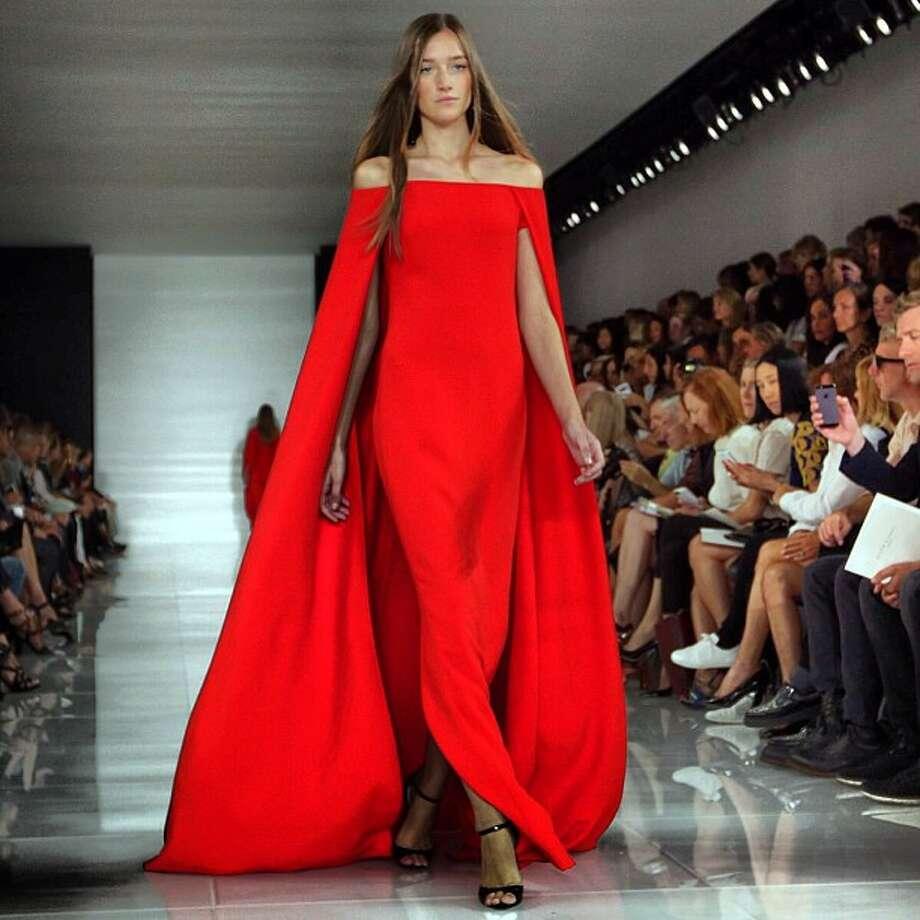 A model walks the runway at the Ralph Lauren show during New York Fashion Week, Thursday, Sept. 12, 2013.(AP Photo/Richard Drew) Photo: Richard Drew, Associated Press / AP