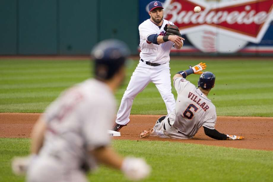 Sept. 21: Indians 4, Astros 1Jose Altuve #27 runs to first on a ground ball as second baseman Jason Kipnis #22 of the Indians forces out Jonathan Villar #6 of the Astros and throws to first for the double play. Photo: Jason Miller, Getty Images