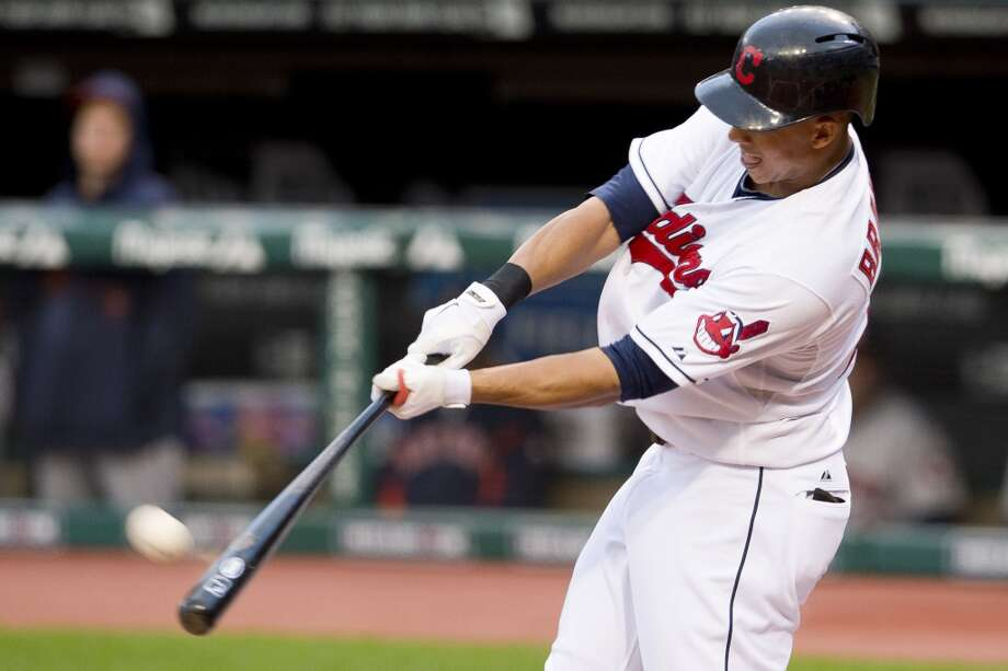 Michael Brantley #23 of the Indians hits a two run home run. Photo: Jason Miller, Getty Images