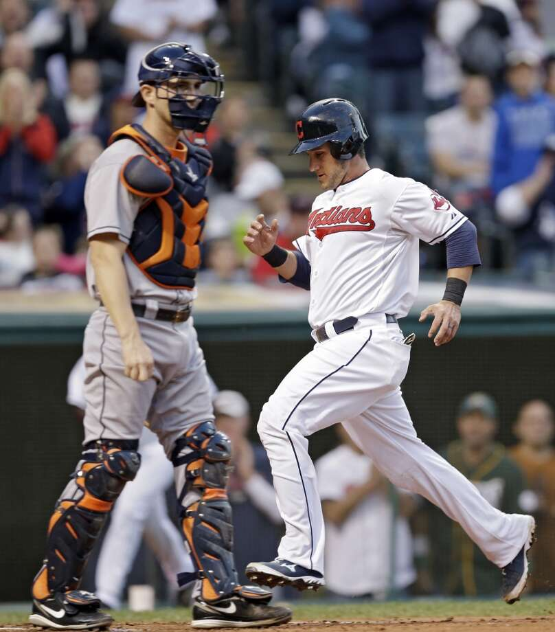 Yan Gomes comes home to score behind Astros catcher Cody Clark on a single by Lonnie Chisenhall. Photo: Mark Duncan, Associated Press