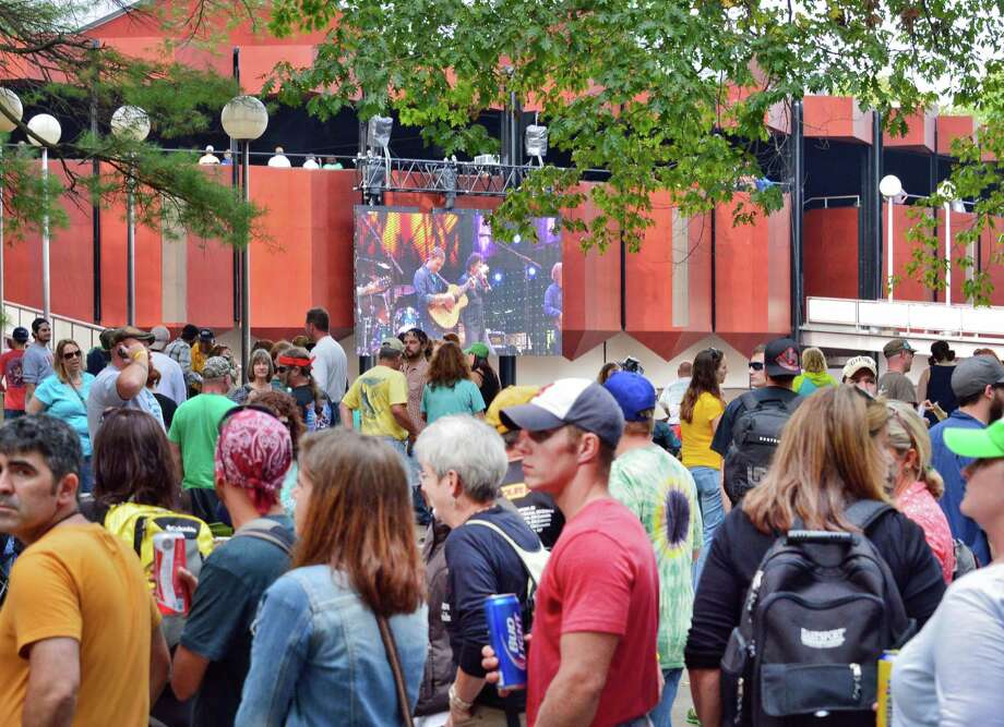 Crowds pack onto the lawn as Toad the Wet Sprocket performs at Farm Aid 2013 at SPAC Saturday Sept. 21, 2013, in Saratoga Springs, NY.  (John Carl D'Annibale / Times Union) Photo: John Carl D'Annibale / 00023919A
