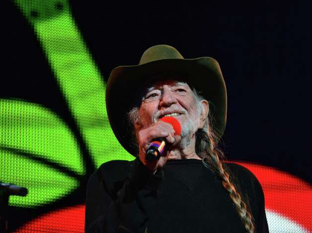 Willie Nelson on stage at Farm Aid 2013 at SPAC Saturday Sept. 21, 2013, in Saratoga Springs, NY.  (John Carl D'Annibale / Times Union) Photo: John Carl D'Annibale / 00023919A