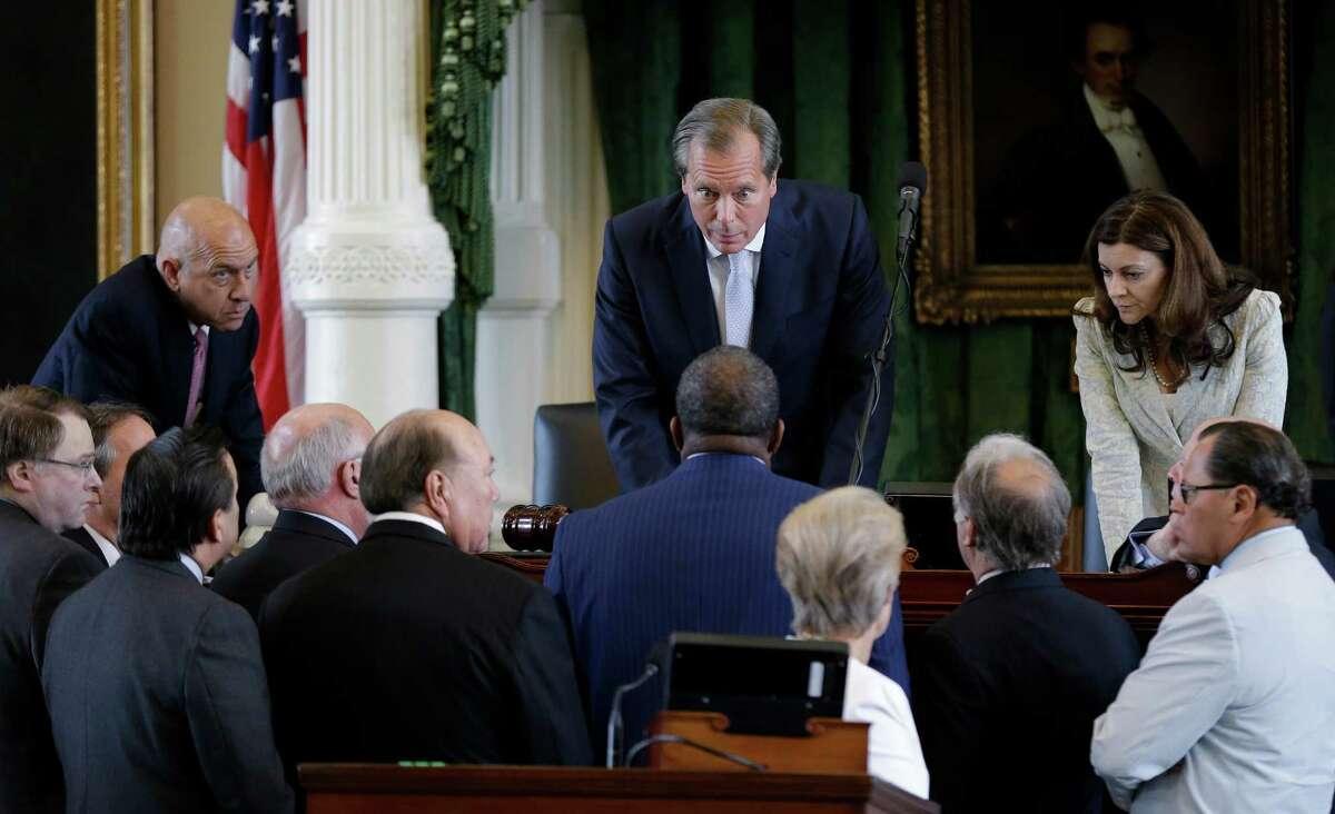 Lt. Gov. David Dewhurst, center, huddles with senators during Sen. Wendy Davis' June filibuster of an abortion bill. Some say it was poor strategy to give Davis a platform that could launch a gubernatorial race.
