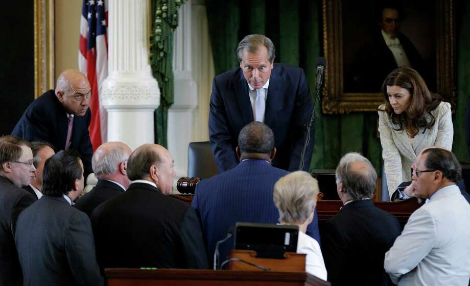 Lt. Gov. David Dewhurst, center, huddles with senators during Sen. Wendy Davis' June filibuster of an abortion bill. Some say it was poor strategy to give Davis a platform that could launch a gubernatorial race. Photo: Eric Gay, STF / AP2013