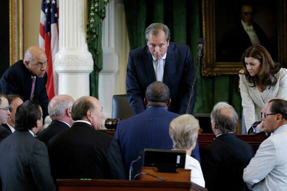 Lt. Gov. David Dewhurst, center, huddles with senators during Sen. Wendy Davis' June filibuster of an abortion bill. Some say it was poor strategy to give Davis a platform that could launch a gubernatorial race.