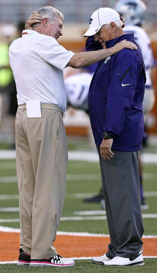 Mack Brown chats with an assistant coach from the opponent as Texas hosts Kansas State at Darrell K. Royal - Texas Memorial Stadium  on September 21, 2013. Photo: TOM REEL