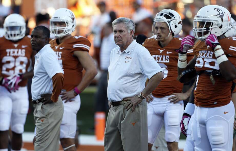 Mack Brown watches the offense warm up as Texas hosts Kansas State at Darrell K. Royal - Texas Memorial Stadium  on September 21, 2013. Photo: TOM REEL