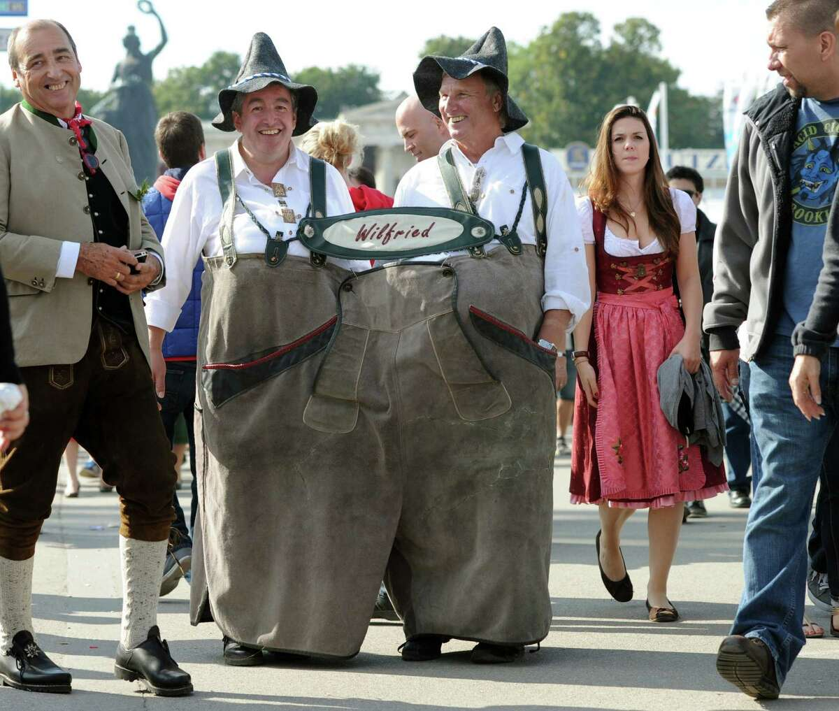 Wilfried and Wilfried, two men from Darmstadt, western Germany, wear together a giant Lederhose (leather trousers) during the Oktoberfest beer festival on the Theresienwiese fair grounds in Munich, southern Germany, on September 21, 2013.