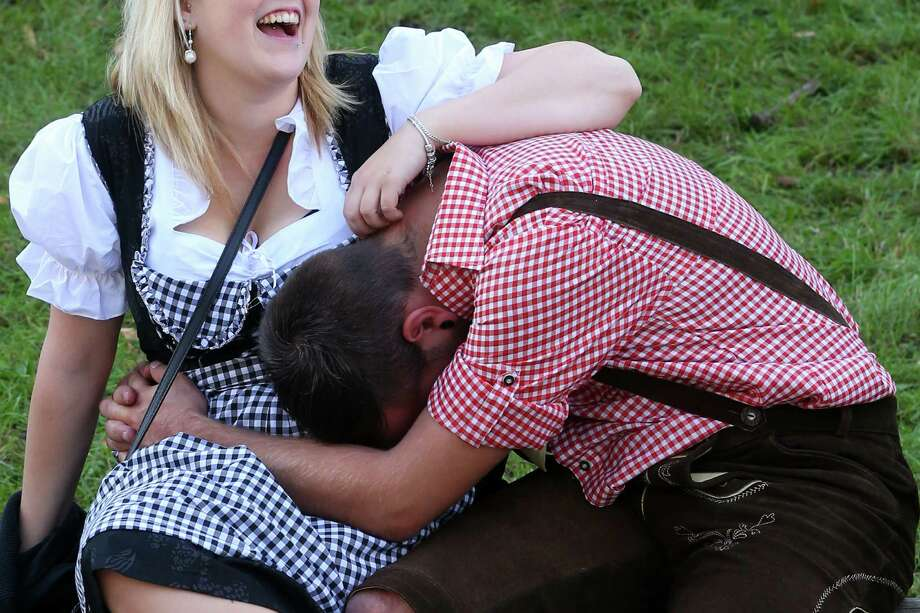 People rest on a meadow during day 1 of the Oktoberfest 2013 beer festival at Theresienwiese on September 21, 2013 in Munich, Germany. Photo: Alexander Hassenstein, Getty Images / 2013 Getty Images