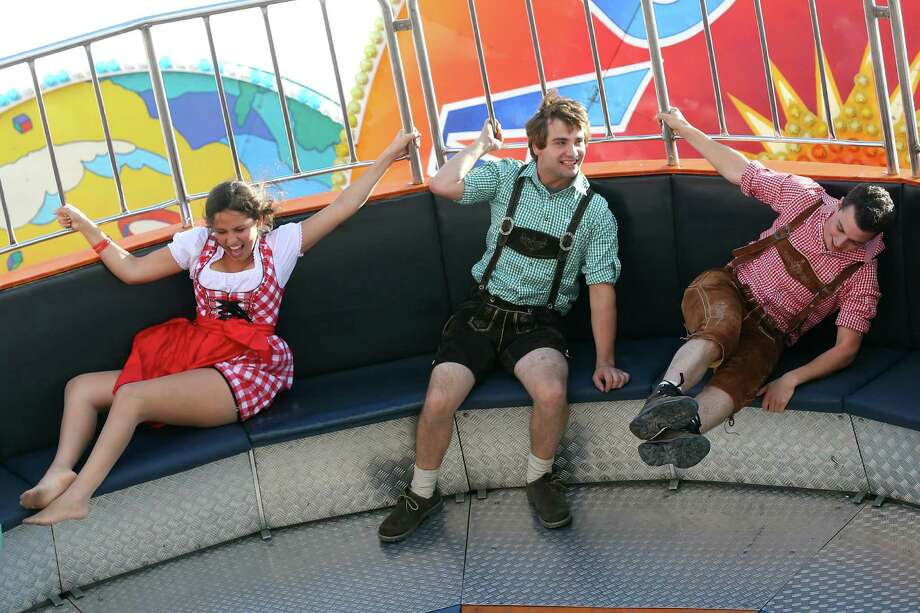 People enjoy riding on fairground ride during day 1 of the Oktoberfest 2013 beer festival at Theresienwiese on September 21, 2013 in Munich, Germany. Photo: Alexander Hassenstein, Getty Images / 2013 Getty Images