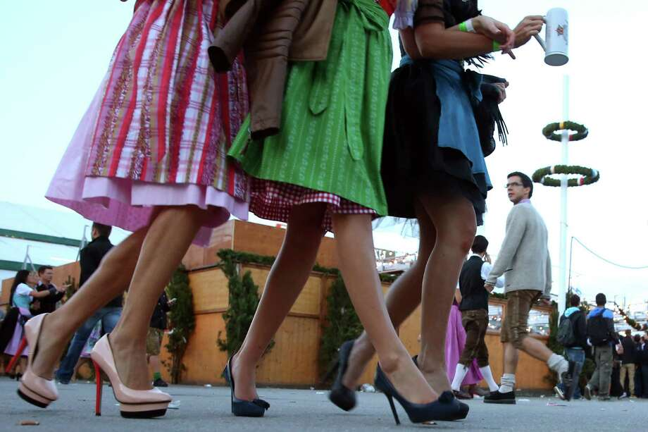 Revellers dressed in traditional Bavarian clothing `Dirndl` walk over the Theresienwiese during day 1 of the Oktoberfest 2013 beer festival at Theresienwiese on September 21, 2013 in Munich, Germany. Photo: Alexander Hassenstein, Getty Images / 2013 Getty Images