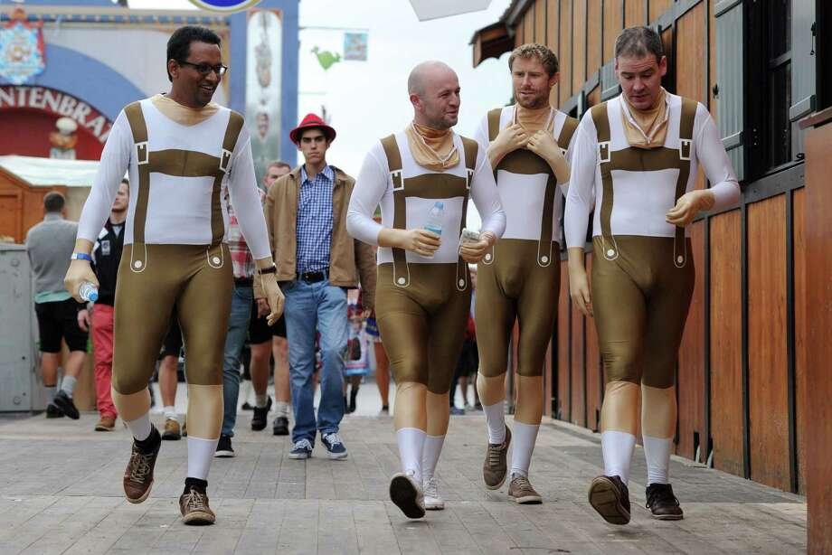 Visitors of the Oktoberfest beer festival wear morphsuits in Lederhosen (leather trousers) design as they walk over the Theresienwiese fair grounds in Munich, southern Germany, on the festival's opening day on September 21, 2013. The world's biggest beer festival Oktoberfest will run until October 6, 2013. Photo: TOBIAS HASE, AFP/Getty Images / DPA