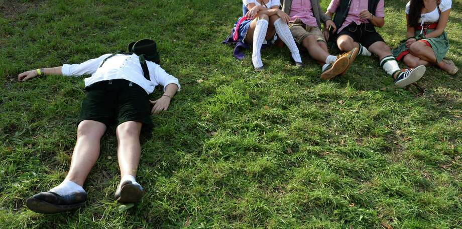 A visitor lays on a meadow during the Oktoberfest beer festival at the Theresienwiese fair grounds in Munich, southern Germany, on the festival's opening day on September 21, 2013. The world's biggest beer festival Oktoberfest will run until October 6, 2013. Photo: CHRISTOF STACHE, AFP/Getty Images / AFP