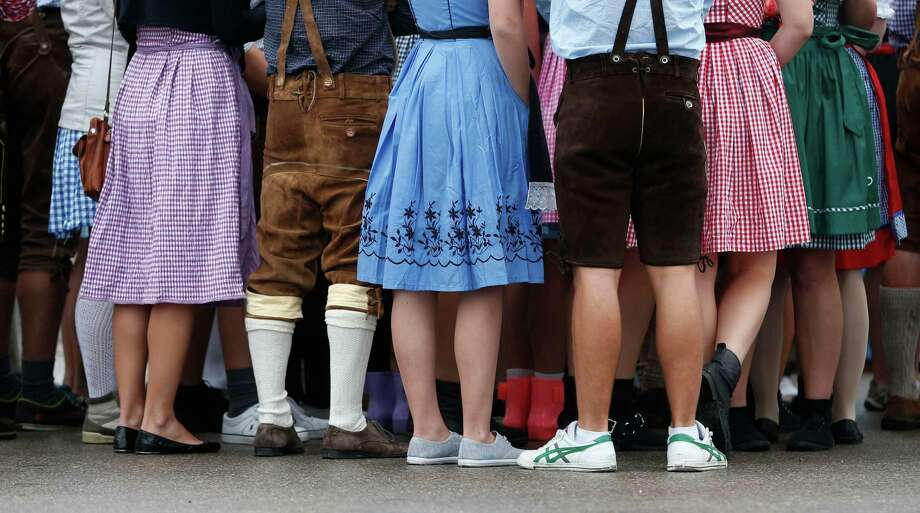"People await the opening of the Bavarian ""Oktoberfest"" beer festival in Munich, southern Germany, Saturday, Sept. 21, 2013. The world's largest beer festival, to be held from Sept. 21 to Oct. 6, 2013, is expected to attract more than six million guests from around the world. Photo: Matthias Schrader, Associated Press / AP"