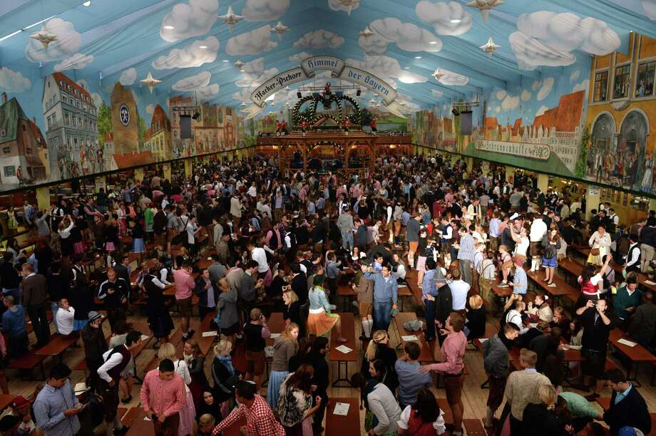 Visitors wait inside a festival tent for the opening of the traditional Bavarian Oktoberfest beer festival at the Theresienwiese in Munich, southern Germany, on September 21, 2013. Photo: CHRISTOF STACHE, AFP/Getty Images / AFP