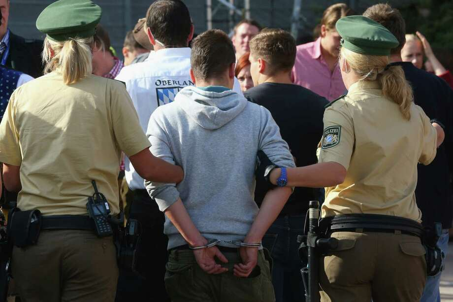 Police arrest a reveller during day 1 of the Oktoberfest 2013 beer festival at Theresienwiese on September 21, 2013 in Munich, Germany. The Munich Oktoberfest, which this year will run from September 21 through October 6, is the world's largest beer fest and draws millions of visitors. Photo: Alexander Hassenstein, Getty Images / 2013 Getty Images