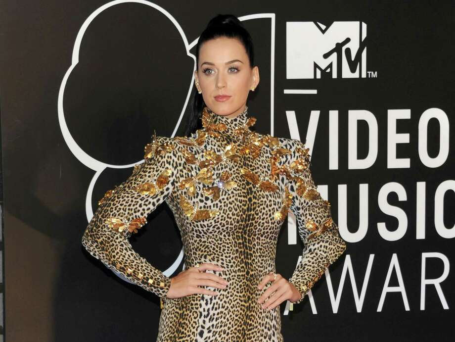 "FILE - This Aug. 25, 2013 file photo shows Katy Perry at the MTV Video Music Awards in the Brooklyn borough of New York. Perry says though she's ""older and wiser,"" she still plans to have fun on her new album. Perry debuted 12 songs from ""Prism"" in front of an audience of 100 industry insiders and journalists Thursday, Sept. 5, in New York. (Photo by Evan Agostini/Invision/AP, File) ORG XMIT: NYET100 Photo: Evan Agostini / Invision"