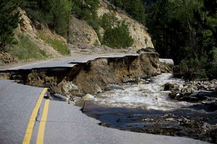 """This road outside Jamestown is one of many damaged by flooding in Colorado. """"It chewed us up,"""" says Jake Brotherton, a glass blower who grew up in Jamestown. Photo: Matthew Staver / New York Times"""