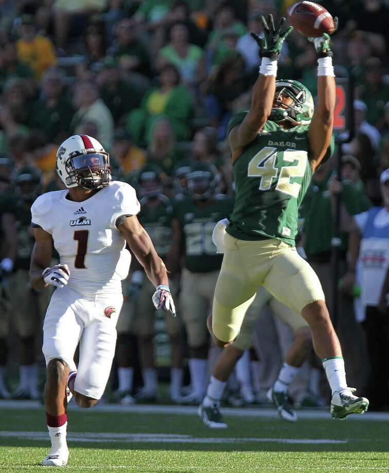 Baylor completes its scoring as Levi Norwood (42) beats Louisiana-Monroe safety Isaiah Newsome on a 65-yard pass from Seth Russell in the third quarter. Photo: Jerry Larson, MBO / Waco Tribune Herald