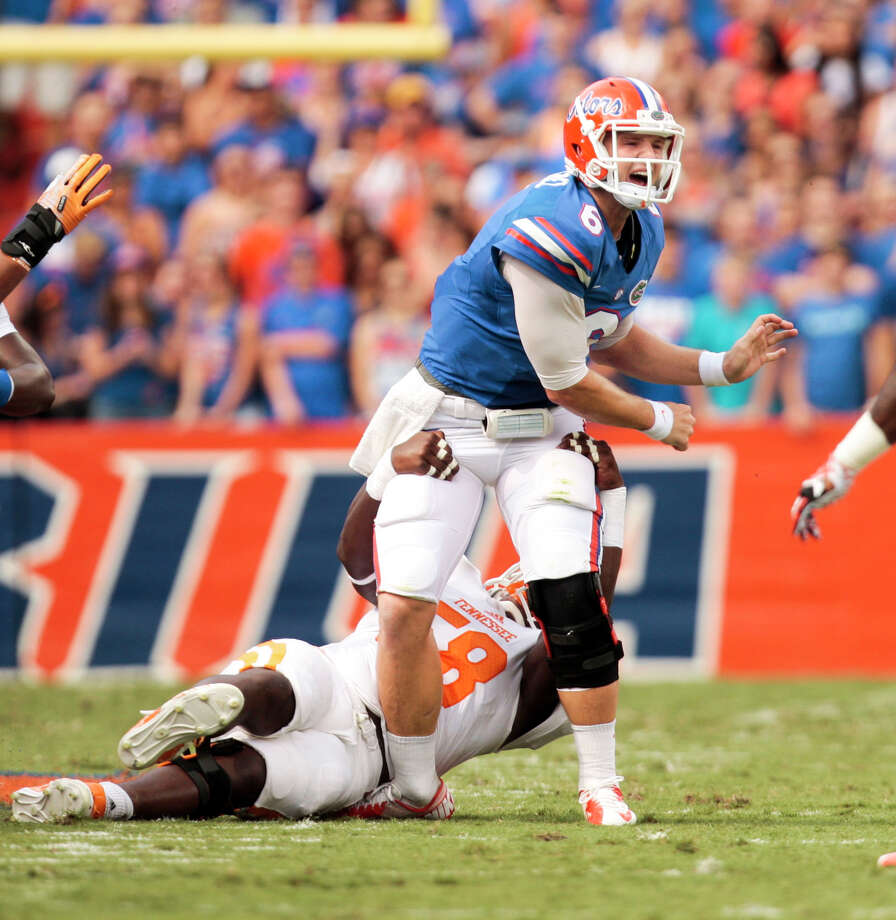 It's a twist and shout situation for Florida quarterback Jeff Driskel, who was lost for the season with a broken leg suffered on this play. Photo: Will Vragovic, MBI / Tampa Bay Times