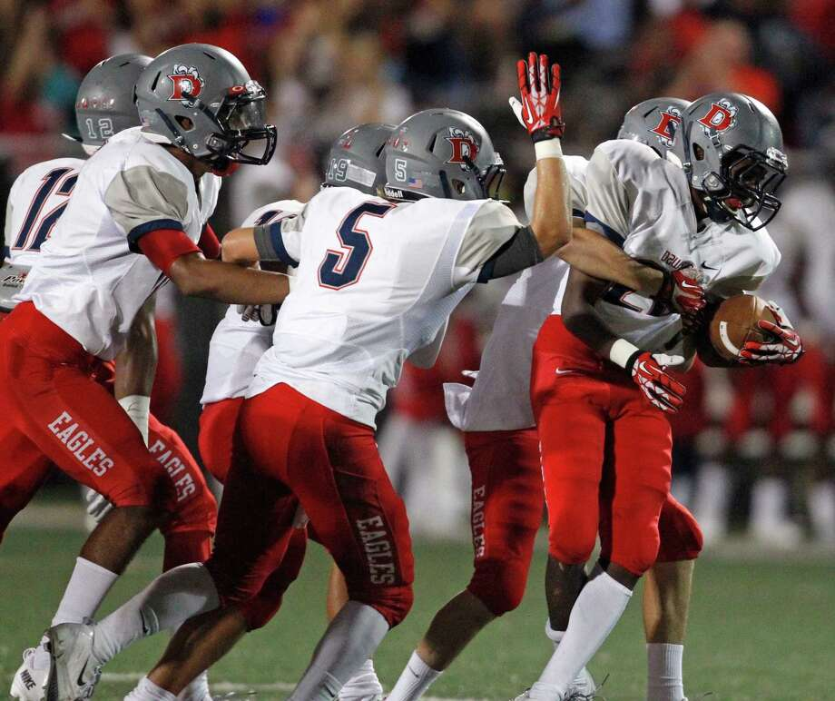 Dawson's James Rhodes, right, celebrates his fumble recovery with teammates during the second half of a high school football game against Clear Falls, Saturday, September 21, 2013 at CCISD Veterans Memorial Stadium in League City. Photo: Eric Christian Smith, For The Chronicle