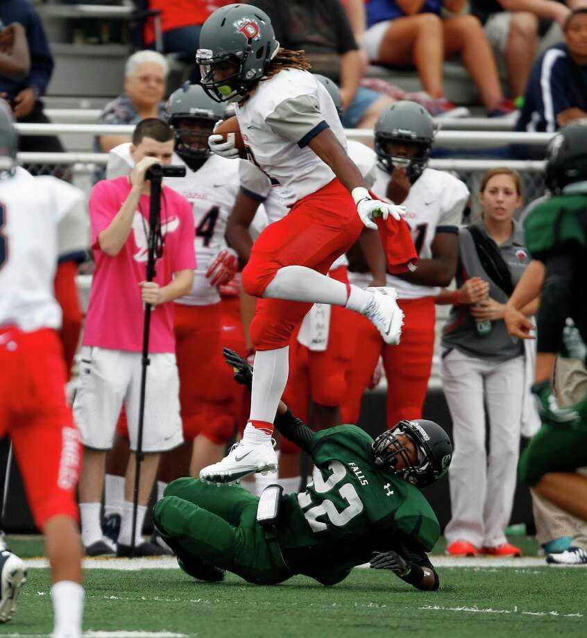 Dawson's Brett Winnegan leaps over Clear Falls' Nick Kelley during the first half of a high school football game, Saturday, September 21, 2013 at CCISD Veterans Memorial Stadium in League City. Photo: Eric Christian Smith, For The Chronicle