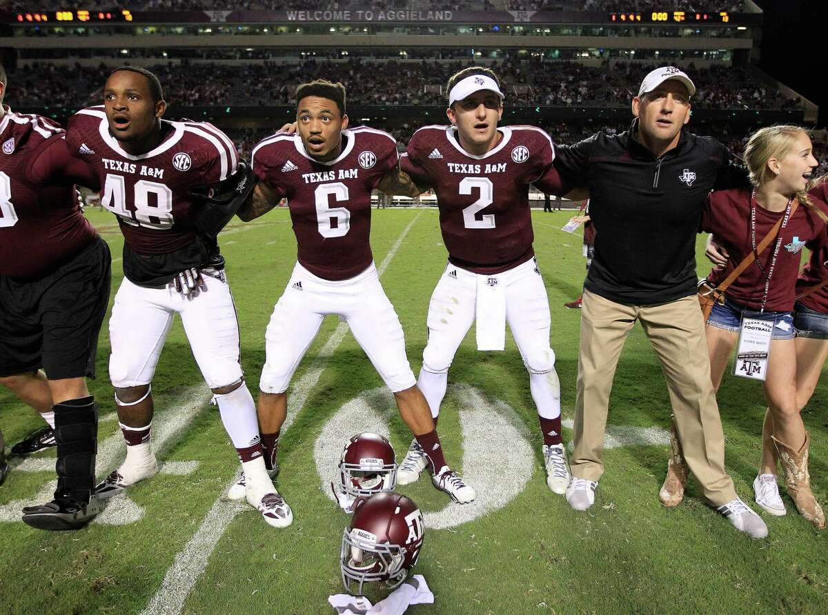 Texas A&M Aggies quarterback Johnny Manziel (2) sings the Aggie War Hymm after their win against Southern Methodist Mustangs at Kyle Stadium, Saturday, Sept. 21, 2013, in Houston. Aggies won the game 42-13.