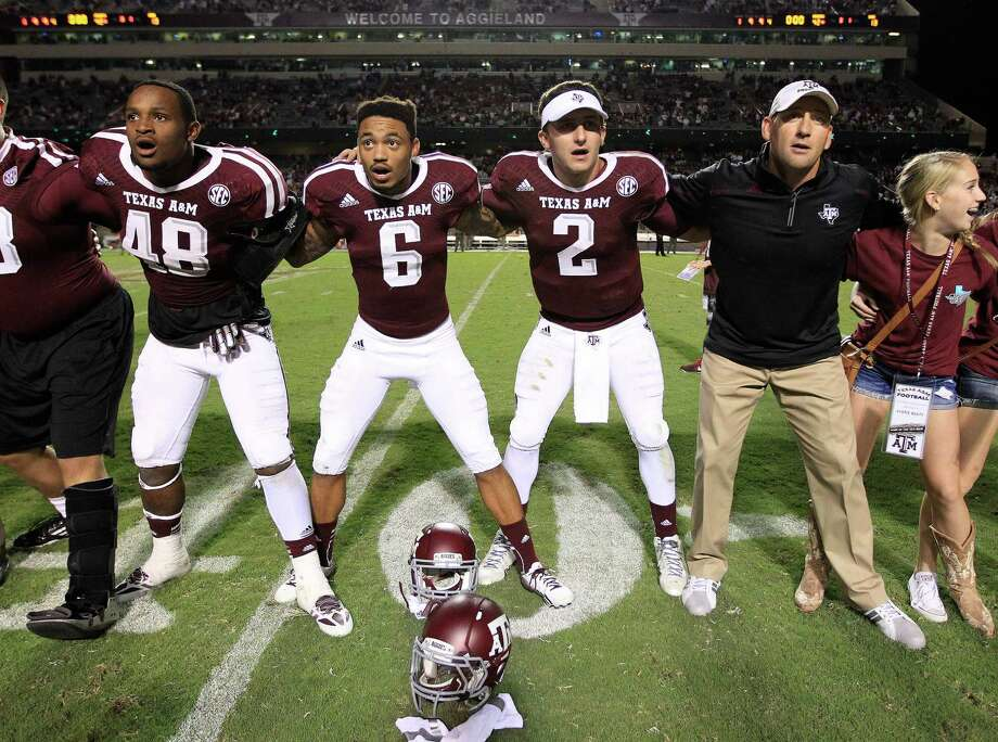 Texas A&M Aggies quarterback Johnny Manziel (2) sings the Aggie War Hymm after their win against Southern Methodist Mustangs at Kyle Stadium, Saturday, Sept. 21, 2013, in Houston. Aggies won the game 42-13. Photo: Karen Warren, Houston Chronicle / © 2013 Houston Chronicle