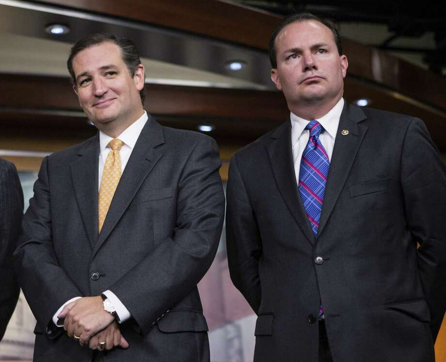 Republican senators Ted Cruz of Texas (left) and Mike Lee of Utah  stand as a  dynamic duo for conservatives. Photo: J. Scott Applewhite / Associated Press