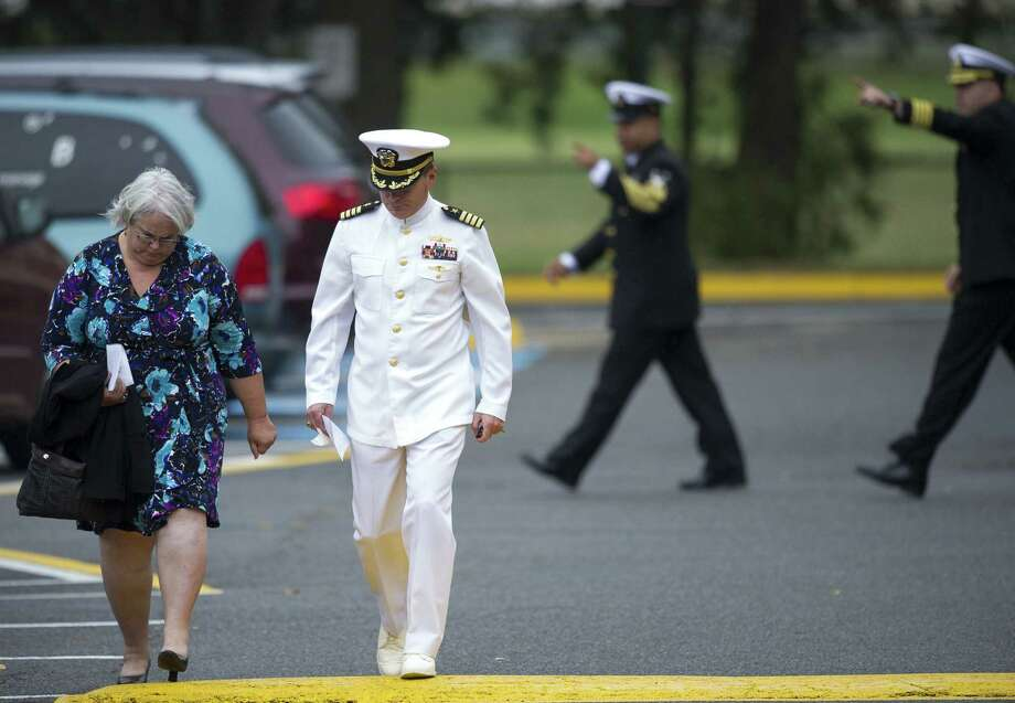 Mourners leave the funeral for Navy Yard shooting victim Martin Bodrog in Springfield, Va. The nation's most recent mass killing could spur people to talk more about mental health care. Photo: Cliff Owen / Associated Press