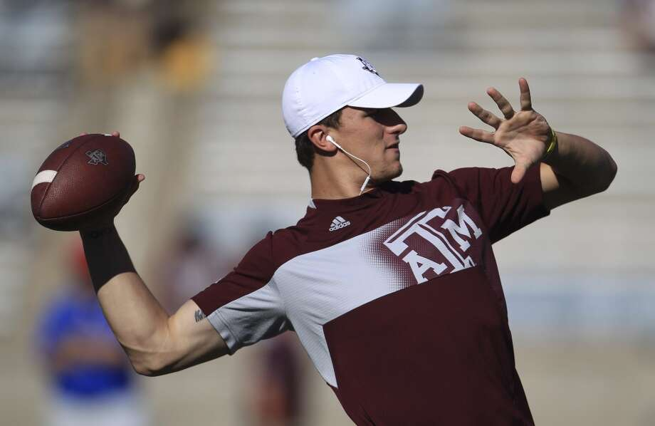 Texas A&M Aggies quarterback Johnny Manziel (2) warms up before the start of a college football game at Kyle Stadium, Saturday, Sept. 21, 2013, in Houston. ( Karen Warren / Houston Chronicle ) Photo: Houston Chronicle