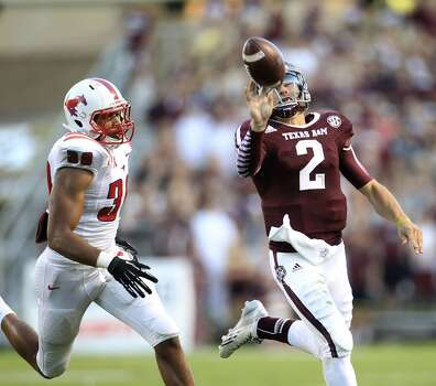 Texas A&M 42, SMU 13Record: 3-1  Texas A&M Aggies quarterback Johnny Manziel (2) bats the ball over to the sideline during the second quarter of a college football game at Kyle Field in College Station. Photo: Karen Warren, Houston Chronicle