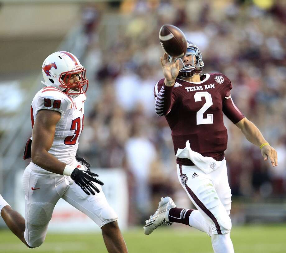 Texas A&M 42, SMU 13Record: 3-1Texas A&M Aggies quarterback Johnny Manziel (2) bats the ball over to the sideline during the second quarter of a college football game at Kyle Field in College Station. Photo: Karen Warren, Houston Chronicle