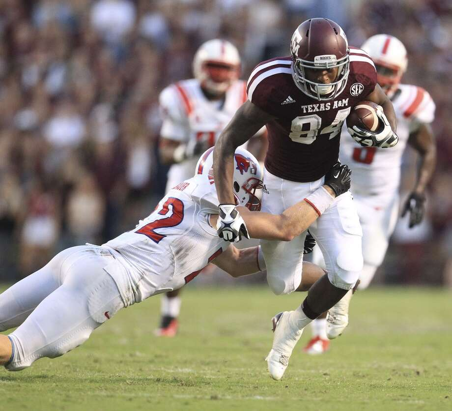 Texas A&M Aggies wide receiver Malcome Kennedy (84) runs the ball against Southern Methodist Mustangs defensive back Hayden Greenbauer (22) during the second quarter. Photo: Karen Warren, Houston Chronicle
