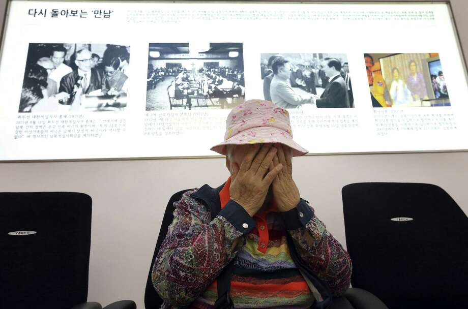 South Korean Cho Jang-geum, 81, weeps in Seoul as she fills out an application form to reunite with her family members who are living in North Korea. The North indefinitely postponed reunions of families separated by the 1950-53 Korean War. Photo: Photos By Park Dong-ju / Associated Press