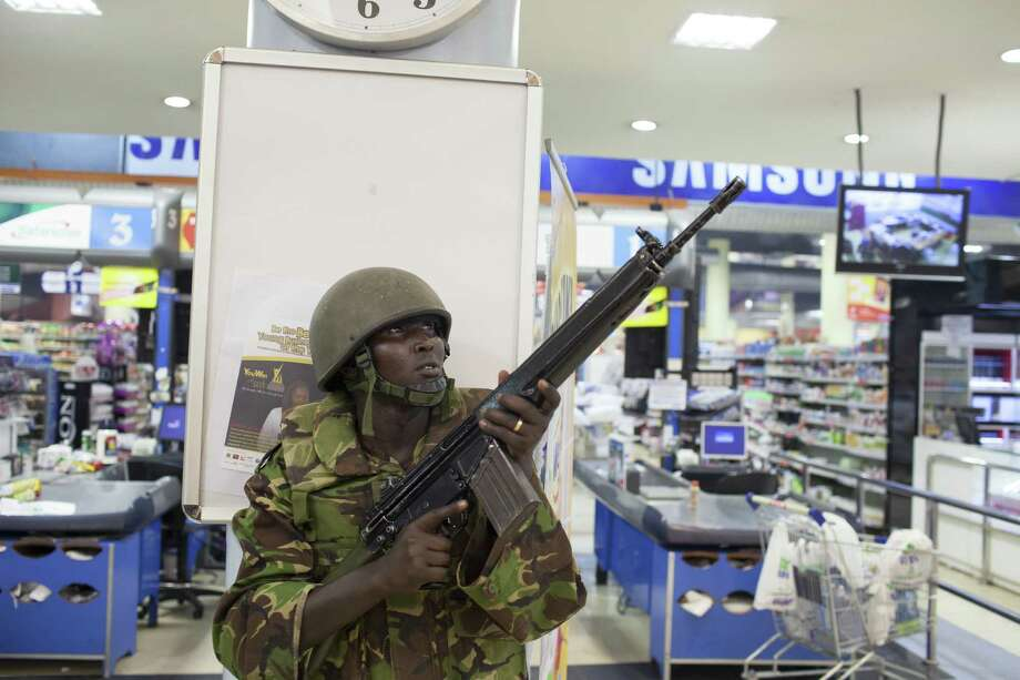 A soldier searches Westgate mall in Nairobi, Kenya, after masked gunmen killed at least 39 people and wounded scores more. The gunmen were holed up in the mall Sunday morning with hostages. Photo: Tyler Hicks / New York Times