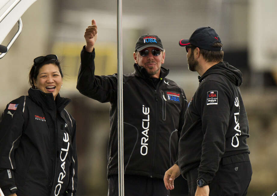 Oracle CEO Larry Ellison (C) gives a thumbs up after Oracle Team USA won against Emirates Team New Zealand during the 34th America's Cup September 20, 2013  in San Francisco. AFP PHOTO/Don EmmertDON EMMERT/AFP/Getty Images ORG XMIT: 167962604 Photo: DON EMMERT / AFP